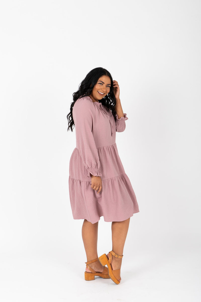 The Walsh Tiered Mini Dress in Mauve, studio shoot; side view
