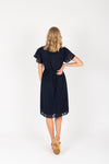 Piper & Scoot: The Evie Dot Wrap Dress in Navy, studio shoot; back view