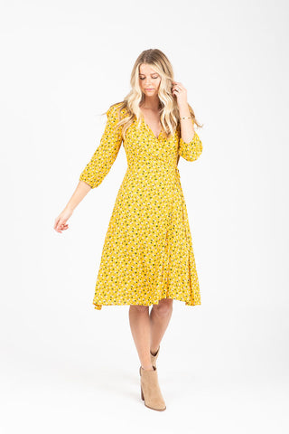 The Belleville Floral Wrap Pleat Dress in Mustard