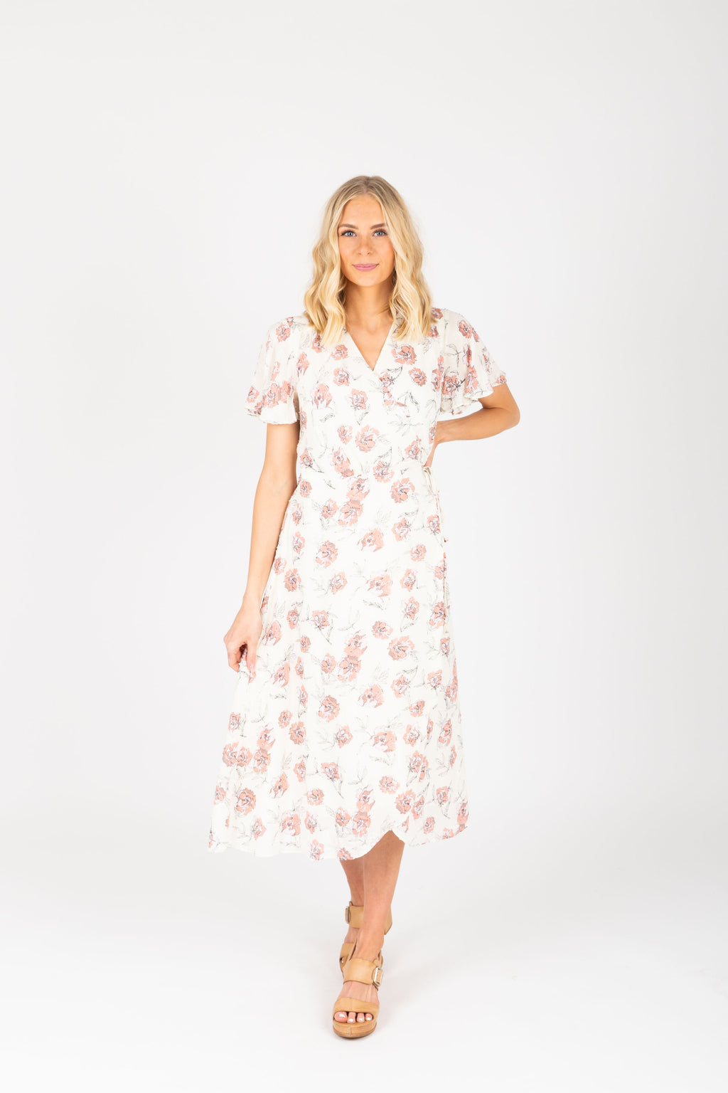 The Tiana Floral Wrap Dress in White, studio shoot; front view