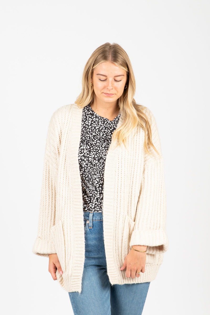 The Carey Knit Chunky Cardigan in Cream, studio shoot; front view