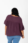 The Thora Pleated Empire Blouse in Burgundy, studio shoot; back view