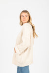 The Carey Knit Chunky Cardigan in Cream, studio shoot; side view
