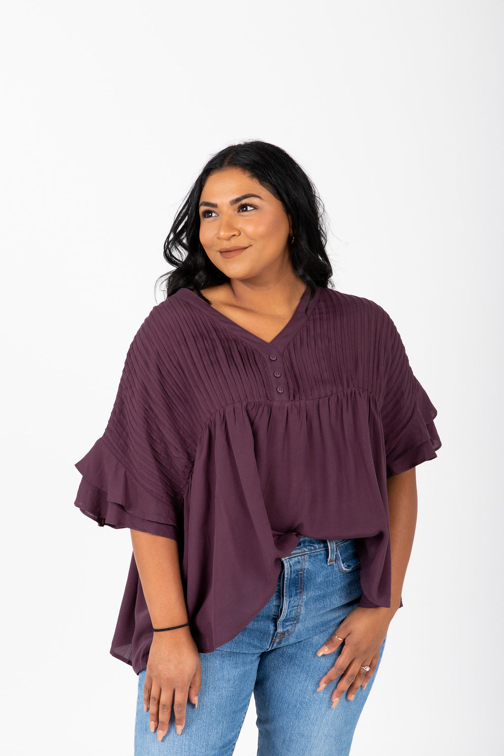 The Thora Pleated Empire Blouse in Burgundy, studio shoot; front view