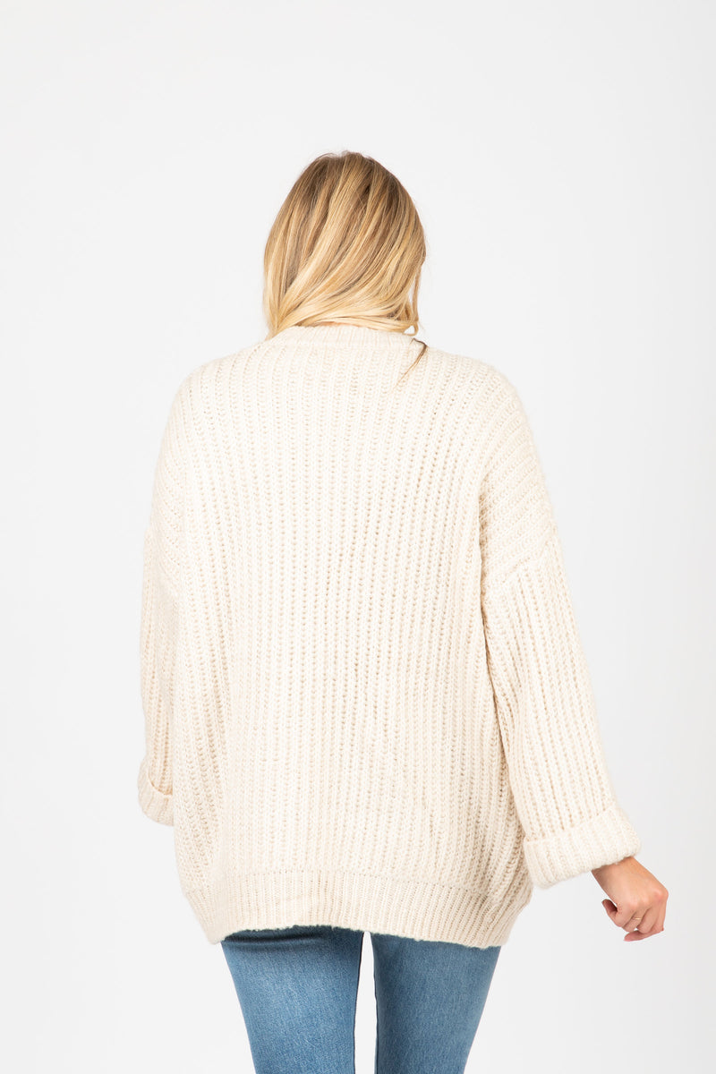 The Carey Knit Chunky Cardigan in Cream, studio shoot; back view