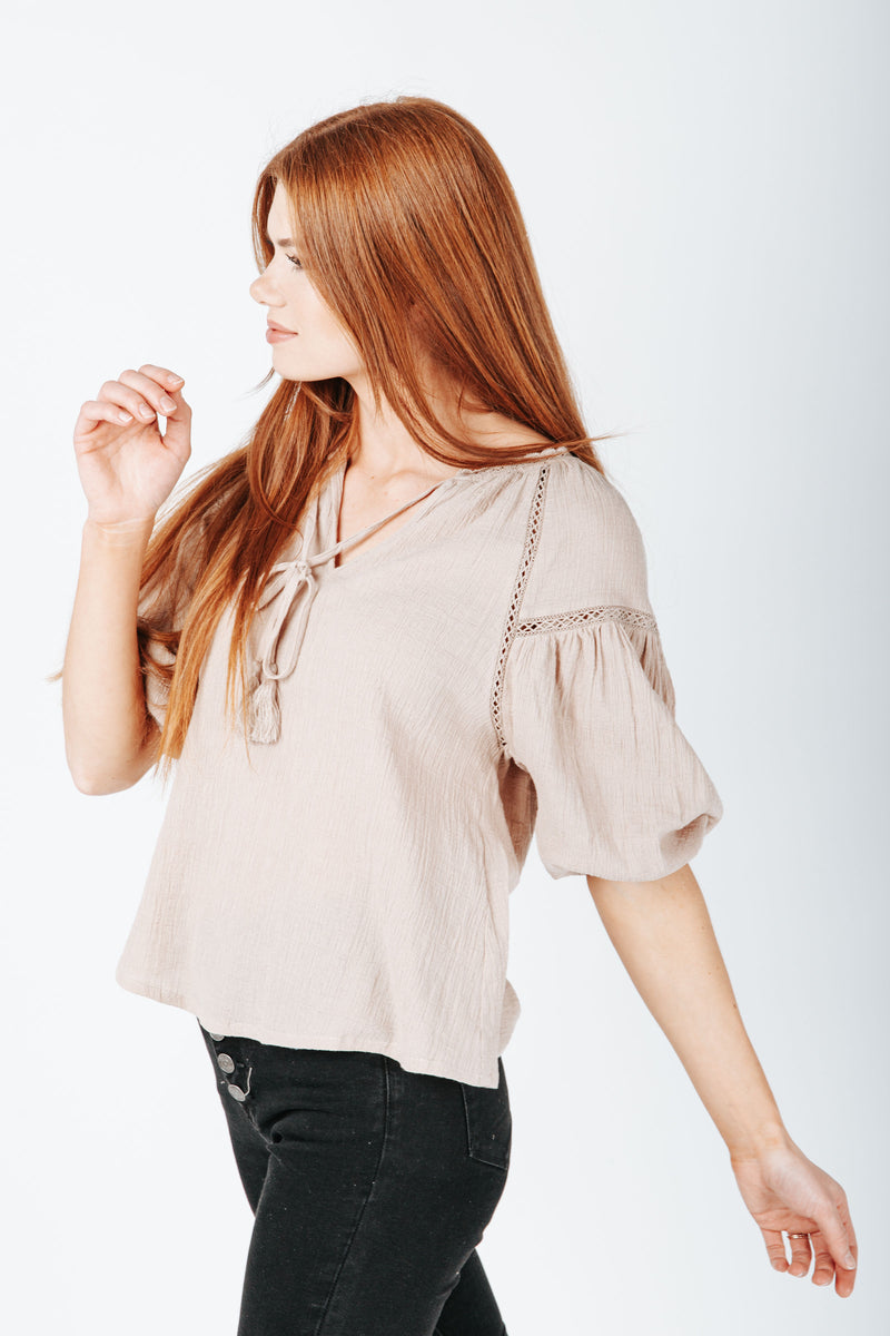 The Mare Lace Detail Blouse in Taupe, studio shoot; side view