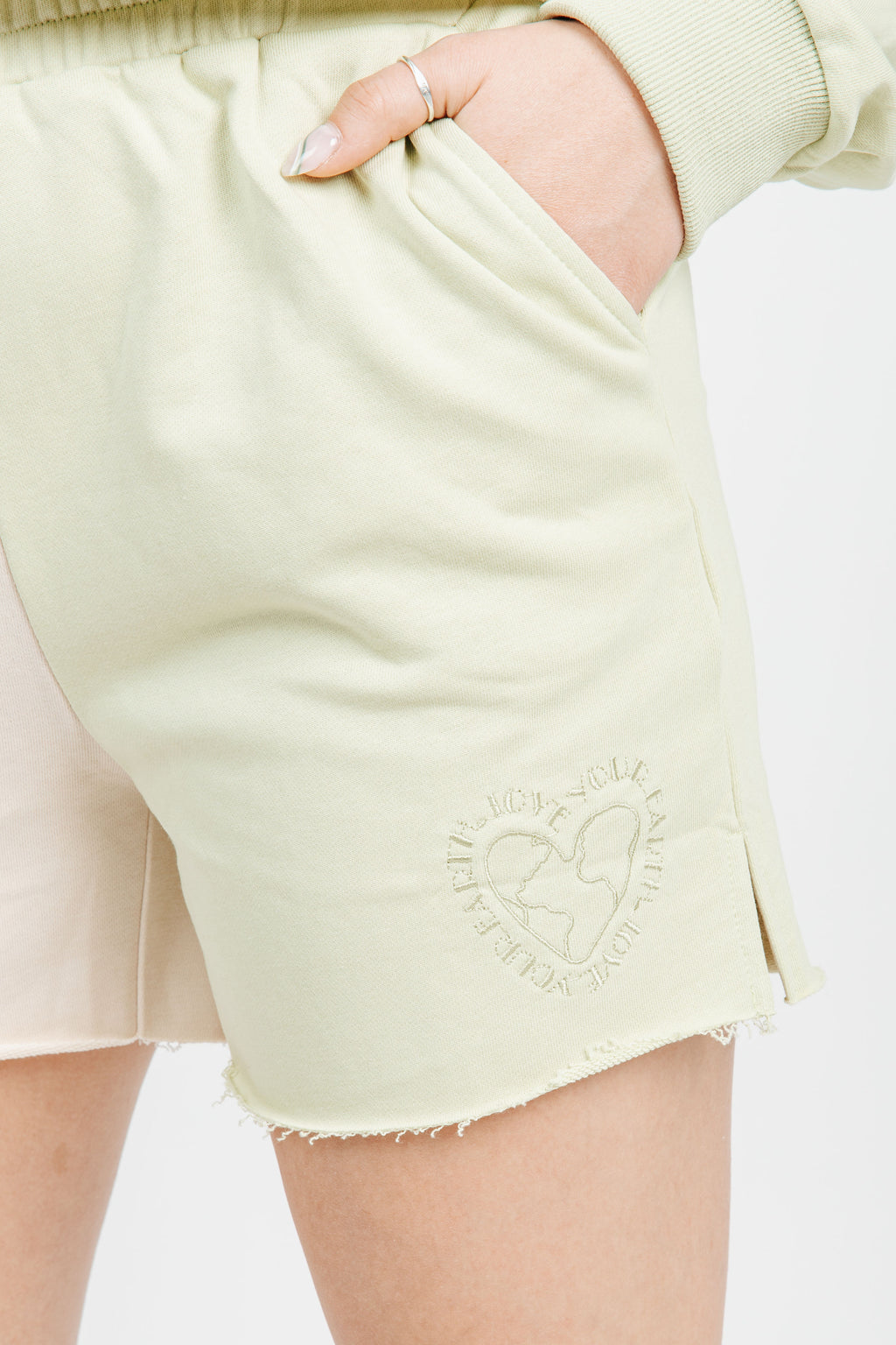 The Love Your Earth Sweat Shorts in Avocado, studio shoot; front view