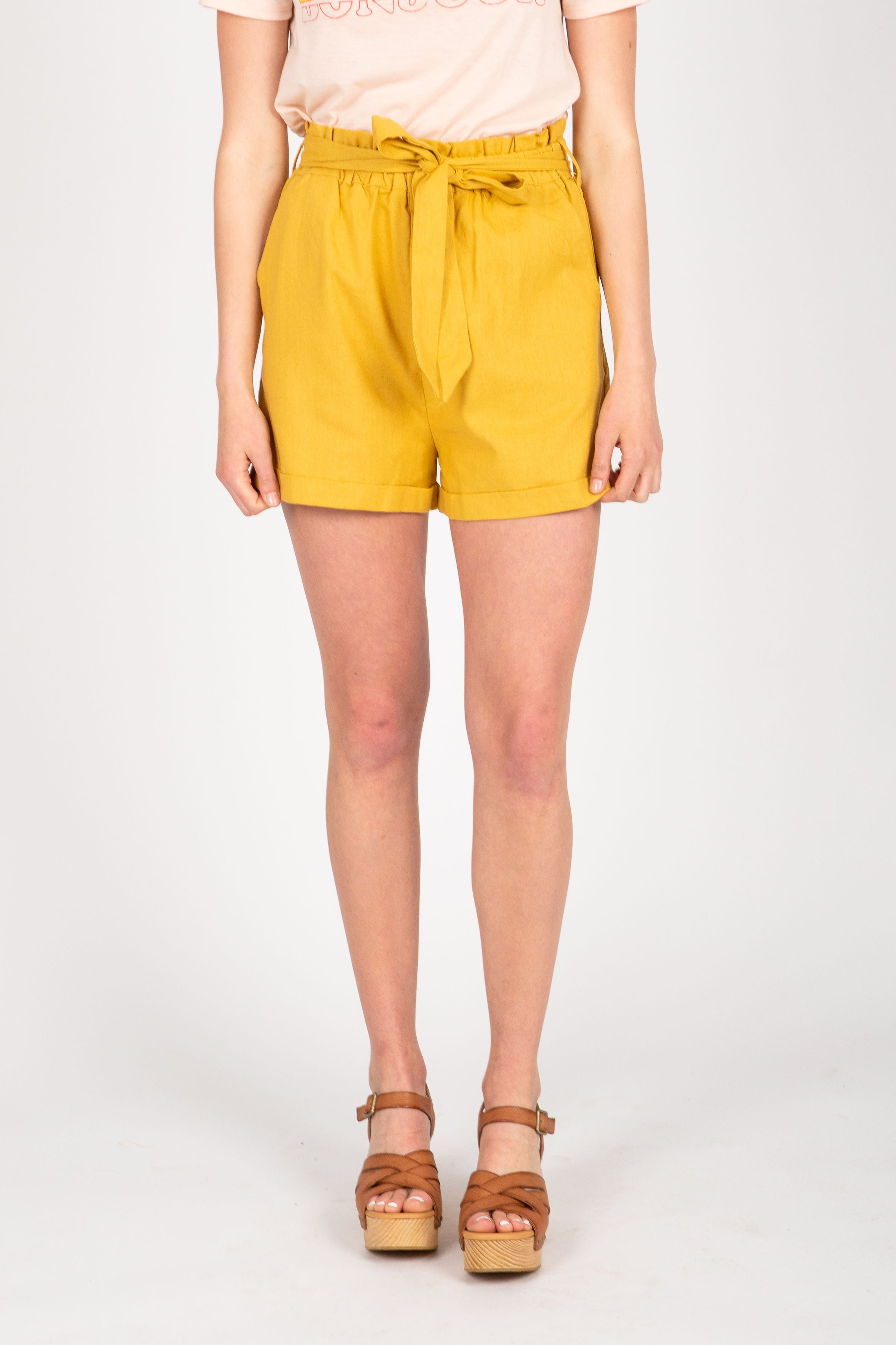 The Era Pleated Shorts in Mustard