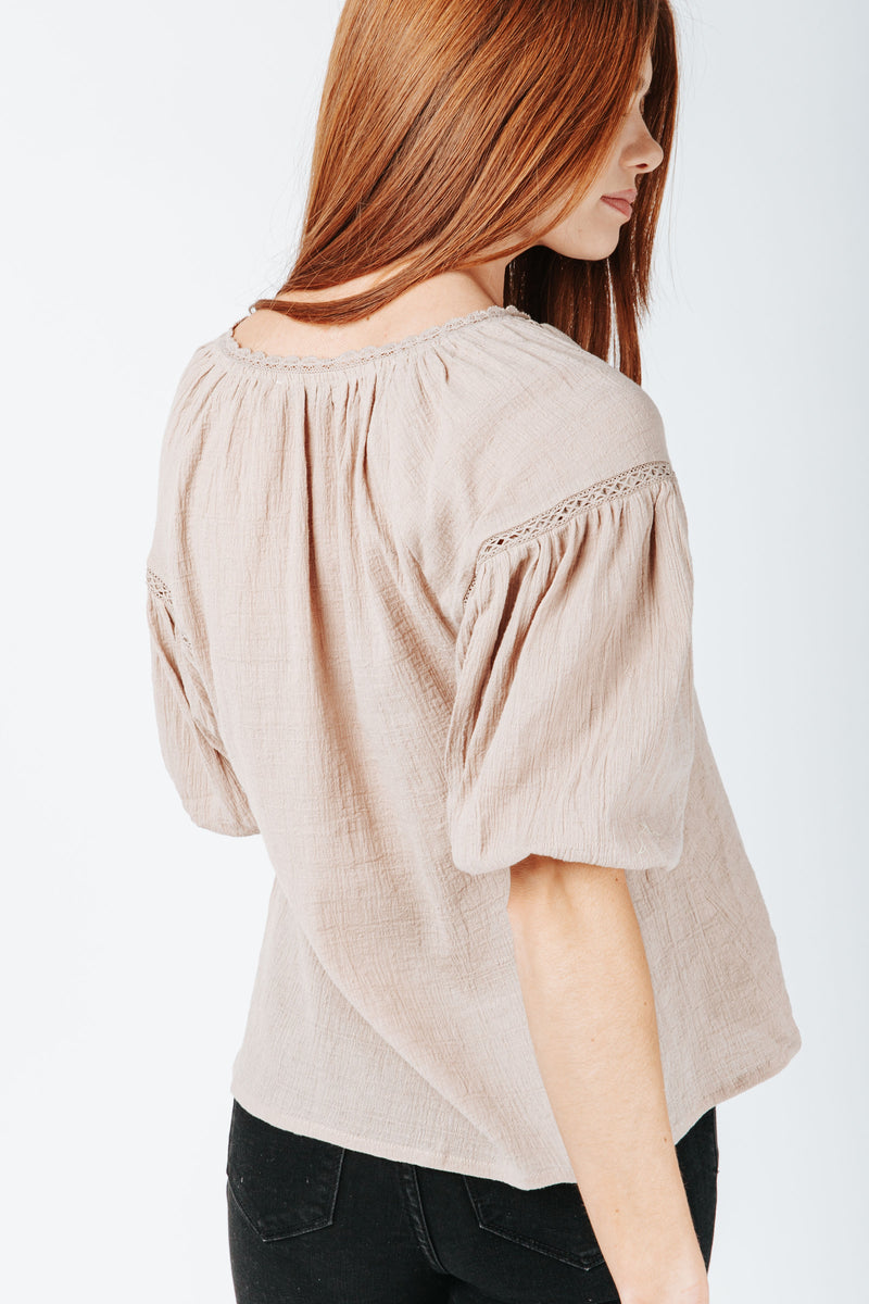 The Mare Lace Detail Blouse in Taupe, studio shoot; back view