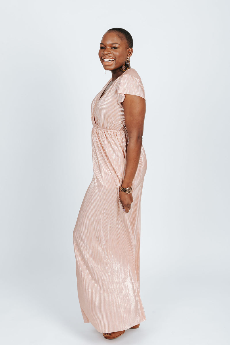 The Stella Shimmer Dress in Blush, studio shoot; side view