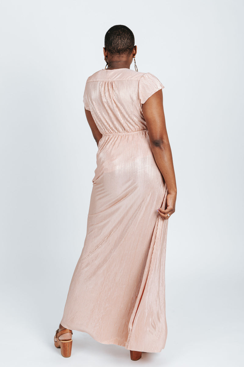 The Stella Shimmer Dress in Blush, studio shoot; back view