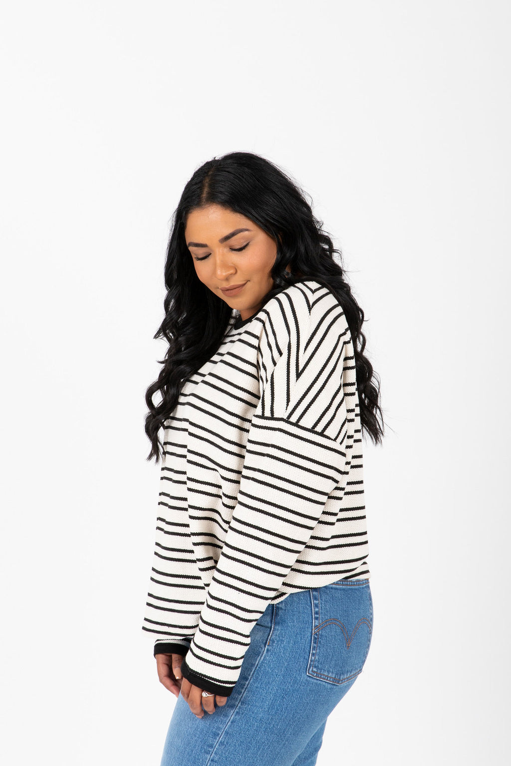 The Decker Striped Knit Sweater in White, studio shoot; side view
