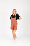 The Mina Shortie Overalls in Brick, studio shoot; front view