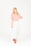 The Coleman Dot Pleated Maxi Skirt in White, studio shoot; front view