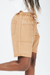 The Hight Drawstring Short in Camel, studio shoot; side view