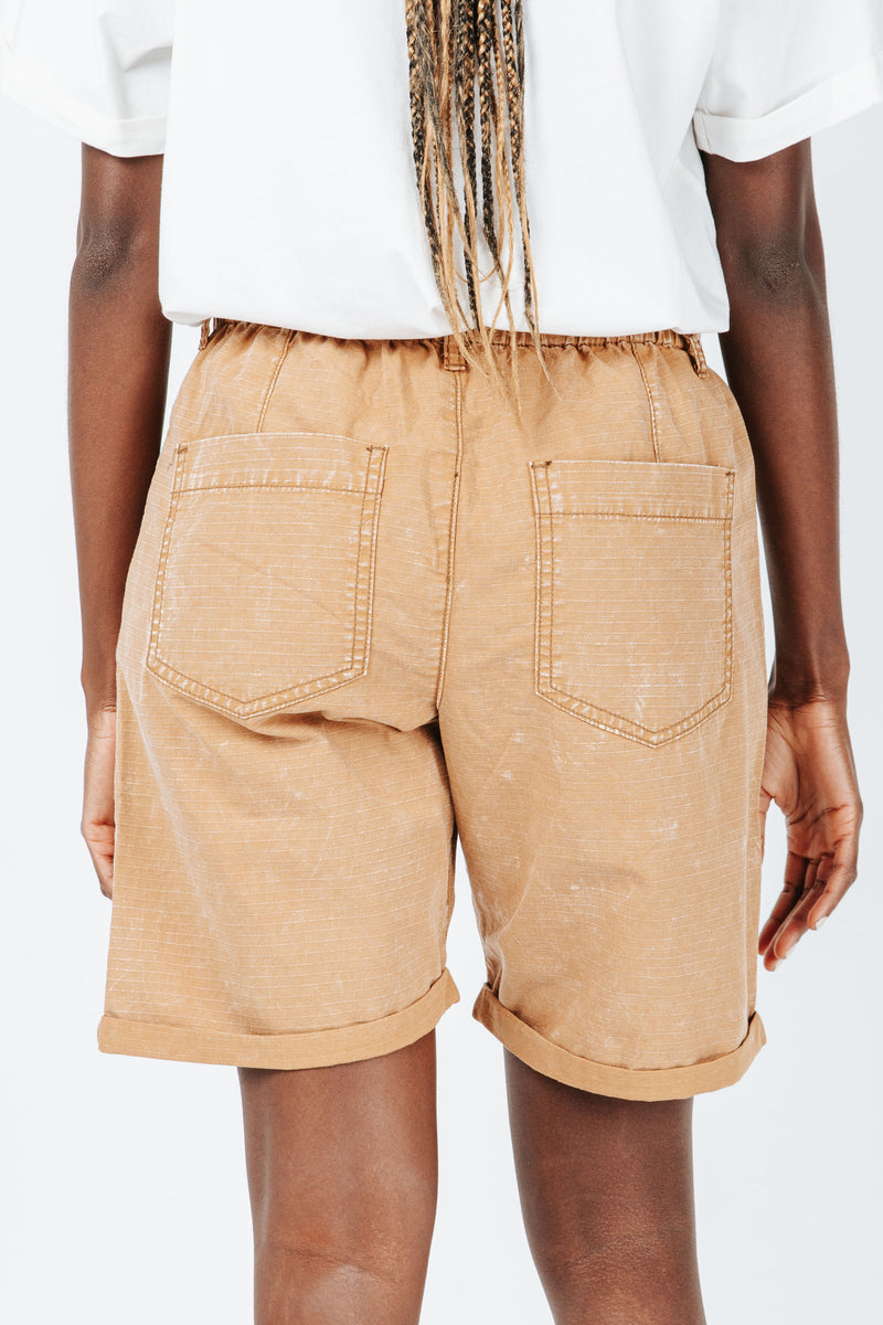 The Hight Drawstring Short in Camel, studio shoot; back view