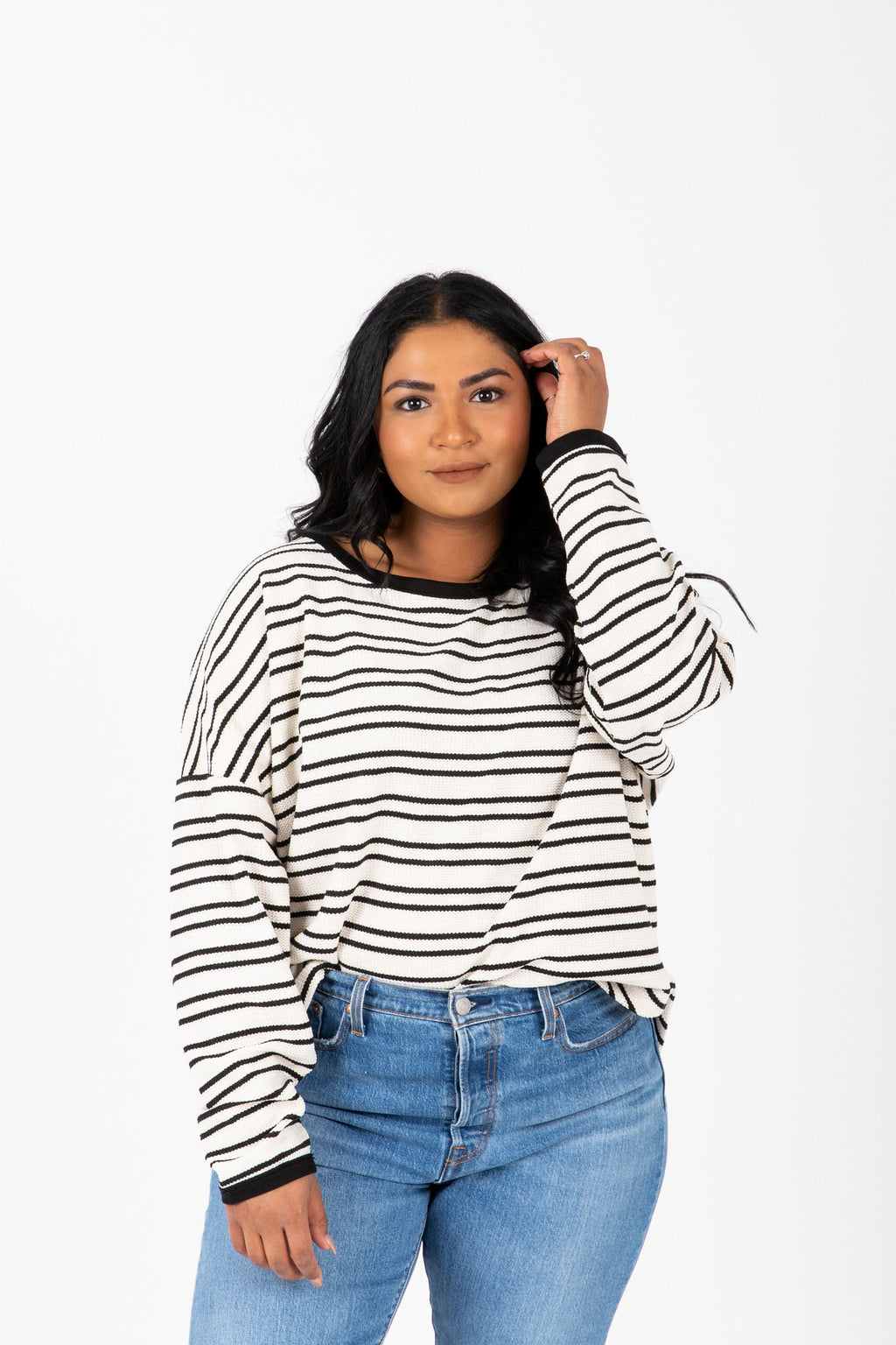 The Decker Striped Knit Sweater in White, studio shoot; front view