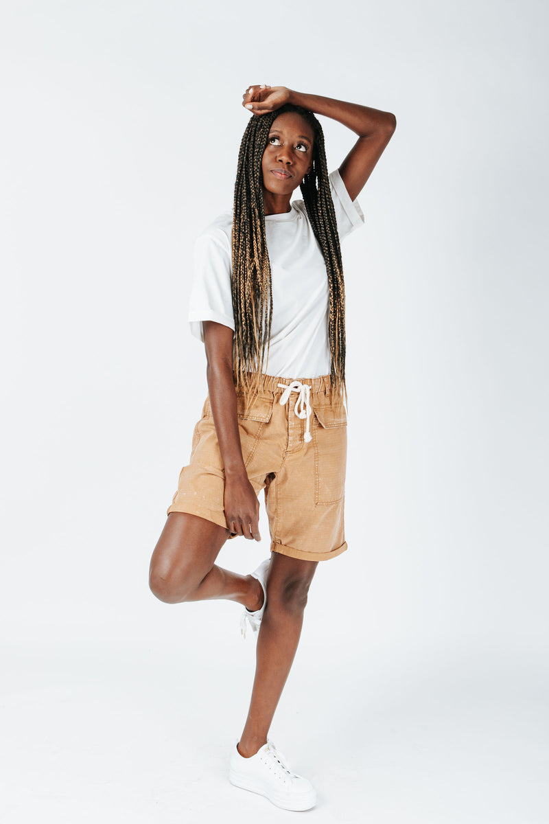 The Hight Drawstring Short in Camel, studio shoot; front view