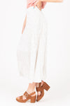 The Coleman Dot Pleated Maxi Skirt in White, studio shoot; side view