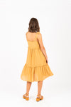 The Carroll Tiered Tank Dress in Mustard, studio shoot; back view