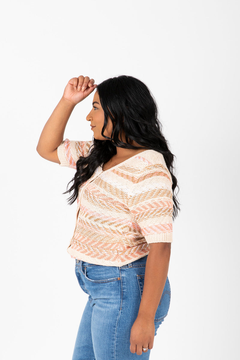 The Omri Striped Button Knit in Oatmeal, studio shoot; side view