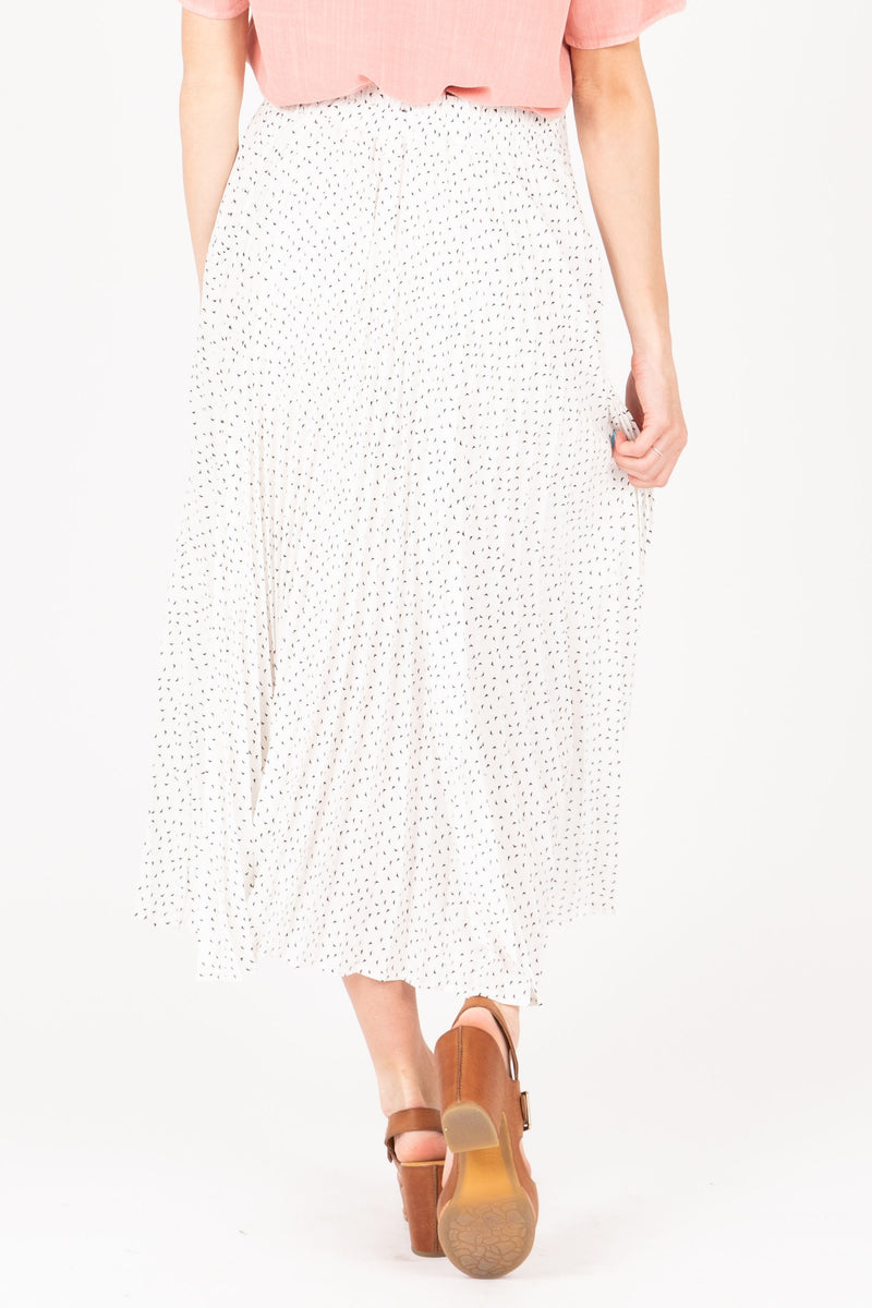 The Coleman Dot Pleated Maxi Skirt in White, studio shoot; back view