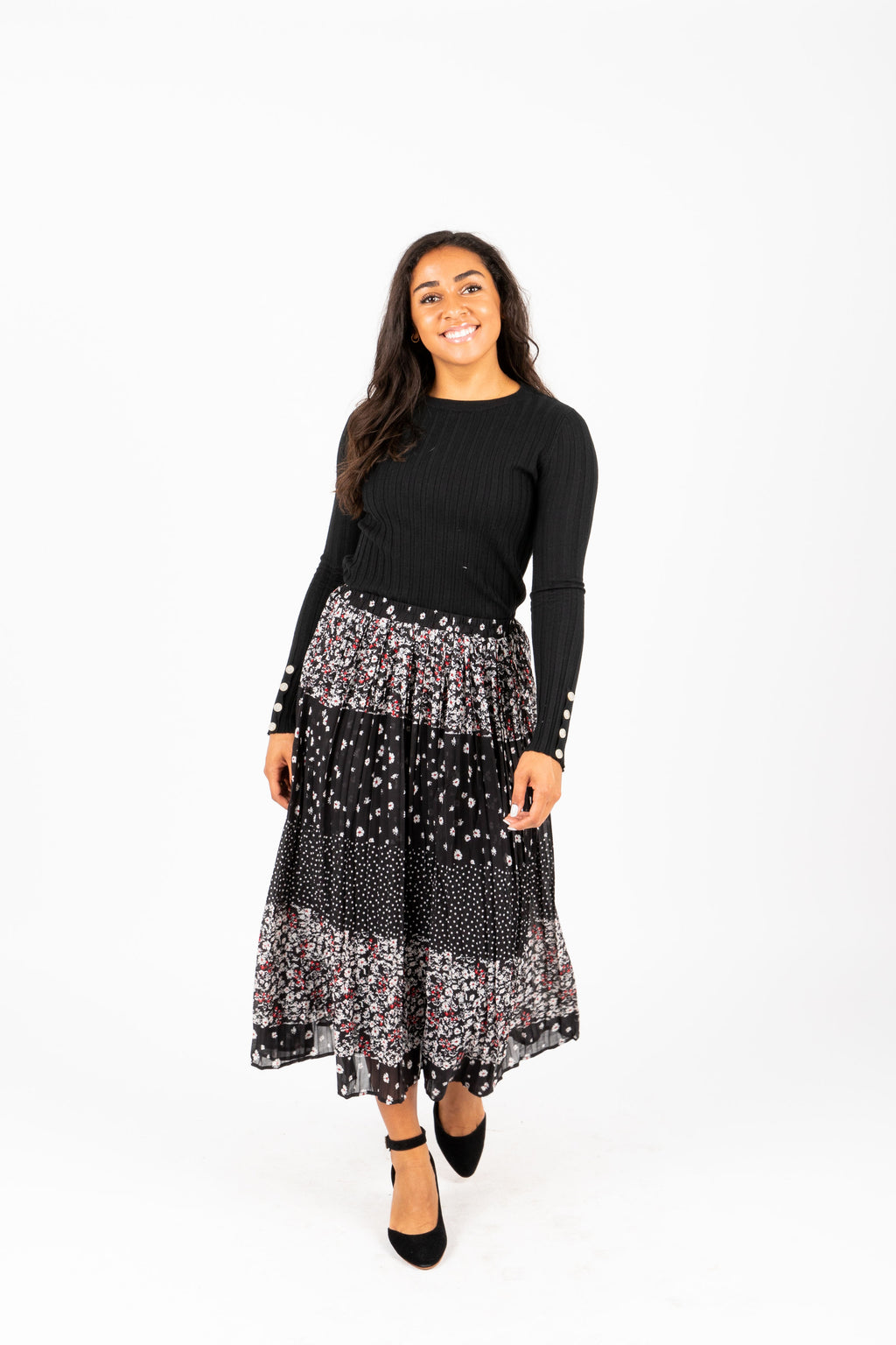 The Marisa Patterned Pleated Skirt in Black, studio shoot; front view