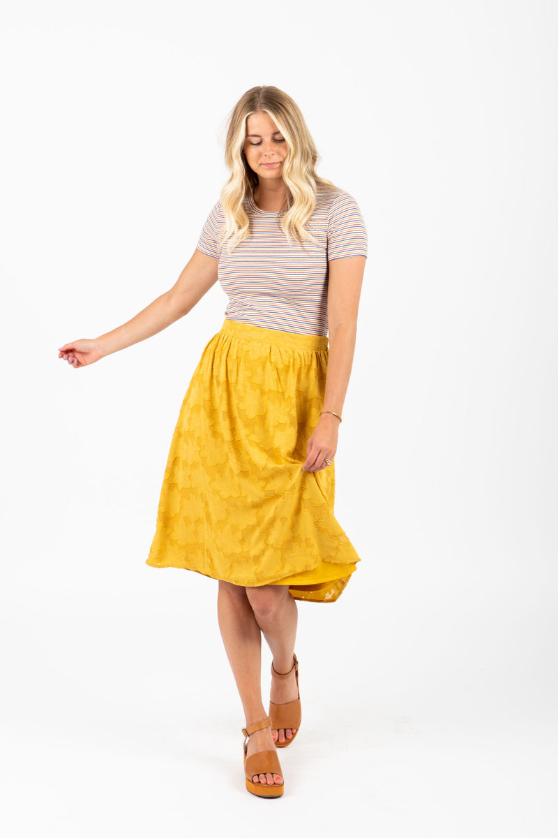 The Mallory Lace Midi Skirt in Mustard
