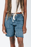 The Hight Drawstring Short in Washed Blue, studio shoot; front view