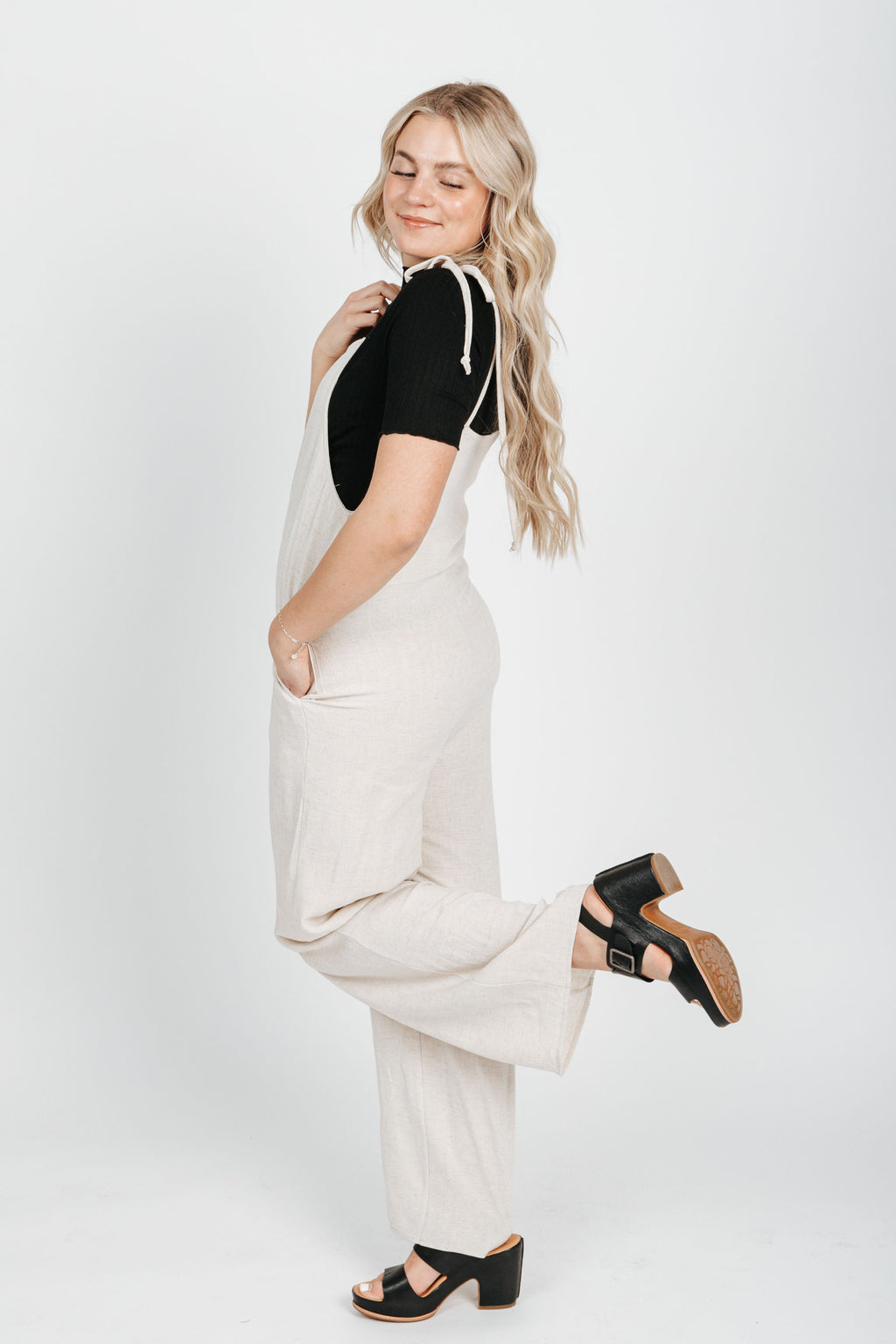 The Marla Tank Jumpsuit in Oatmeal, studio shoot; side view