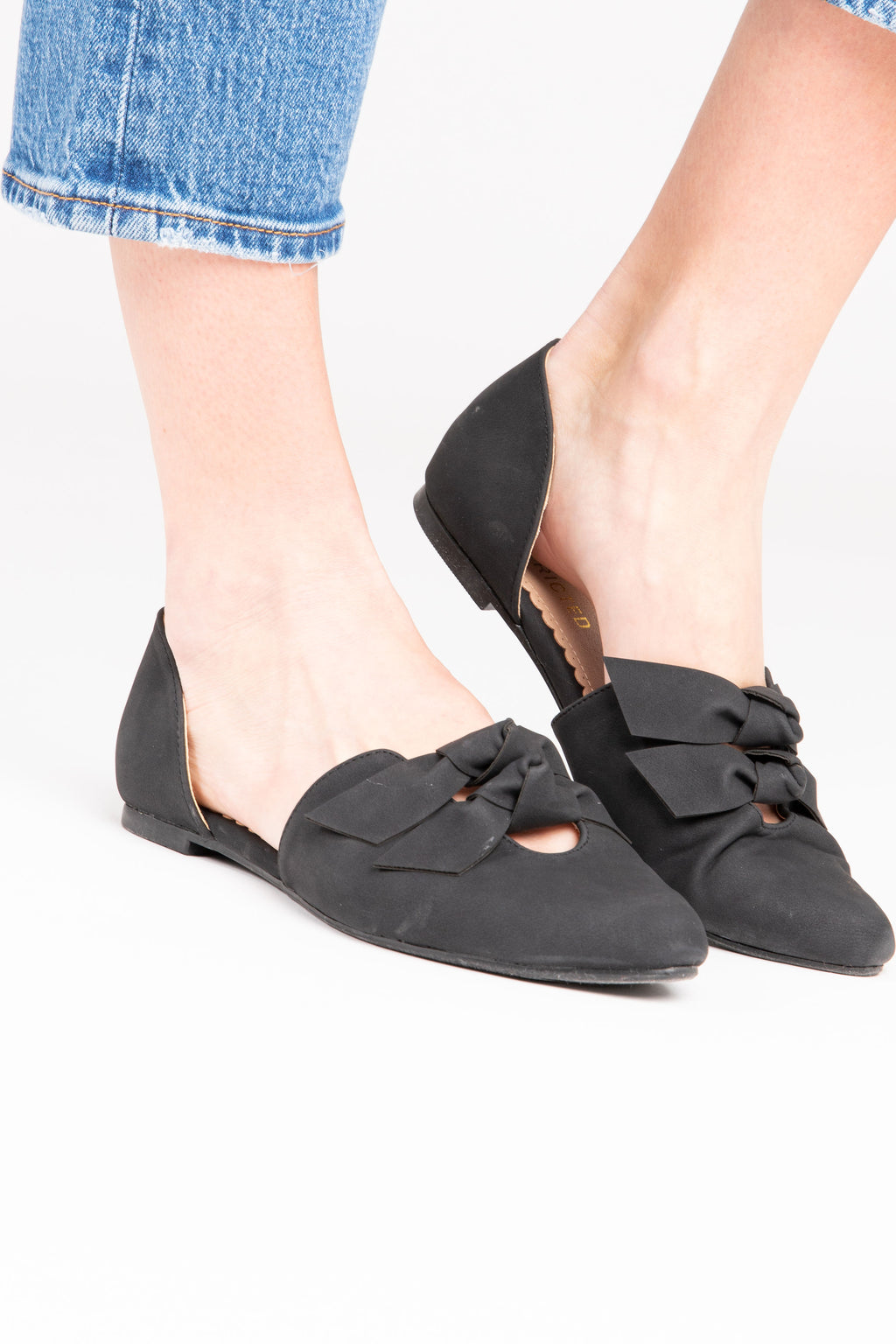 The GABIA Knotted d'Orsay Flat in Black, studio shoot; side view