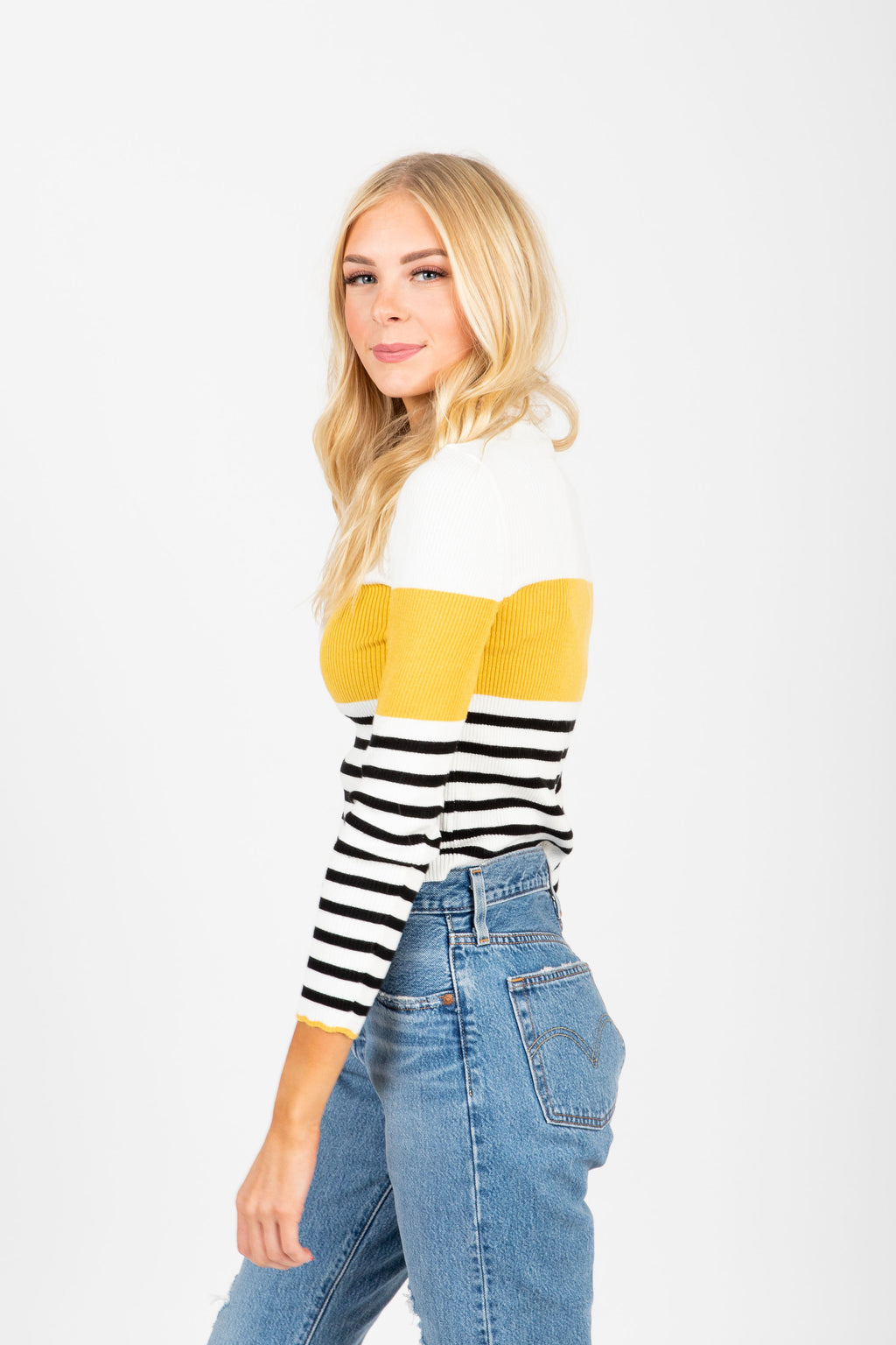 The Covet Striped Sweater Blouse in Mustard, studio shoot; side view