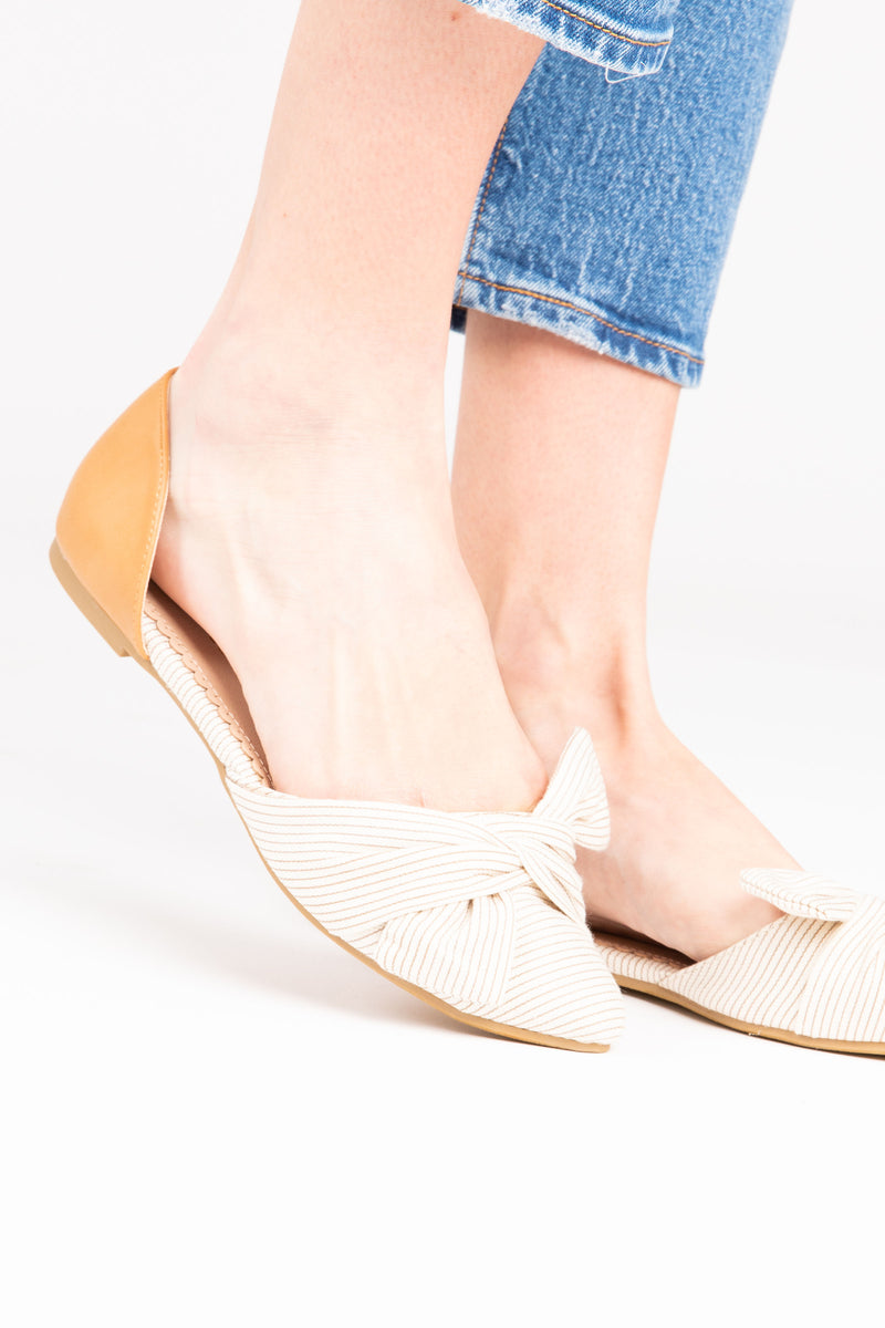 The JASMINA d'Orsay Flat in Natural/Camel, studio shoot; side view