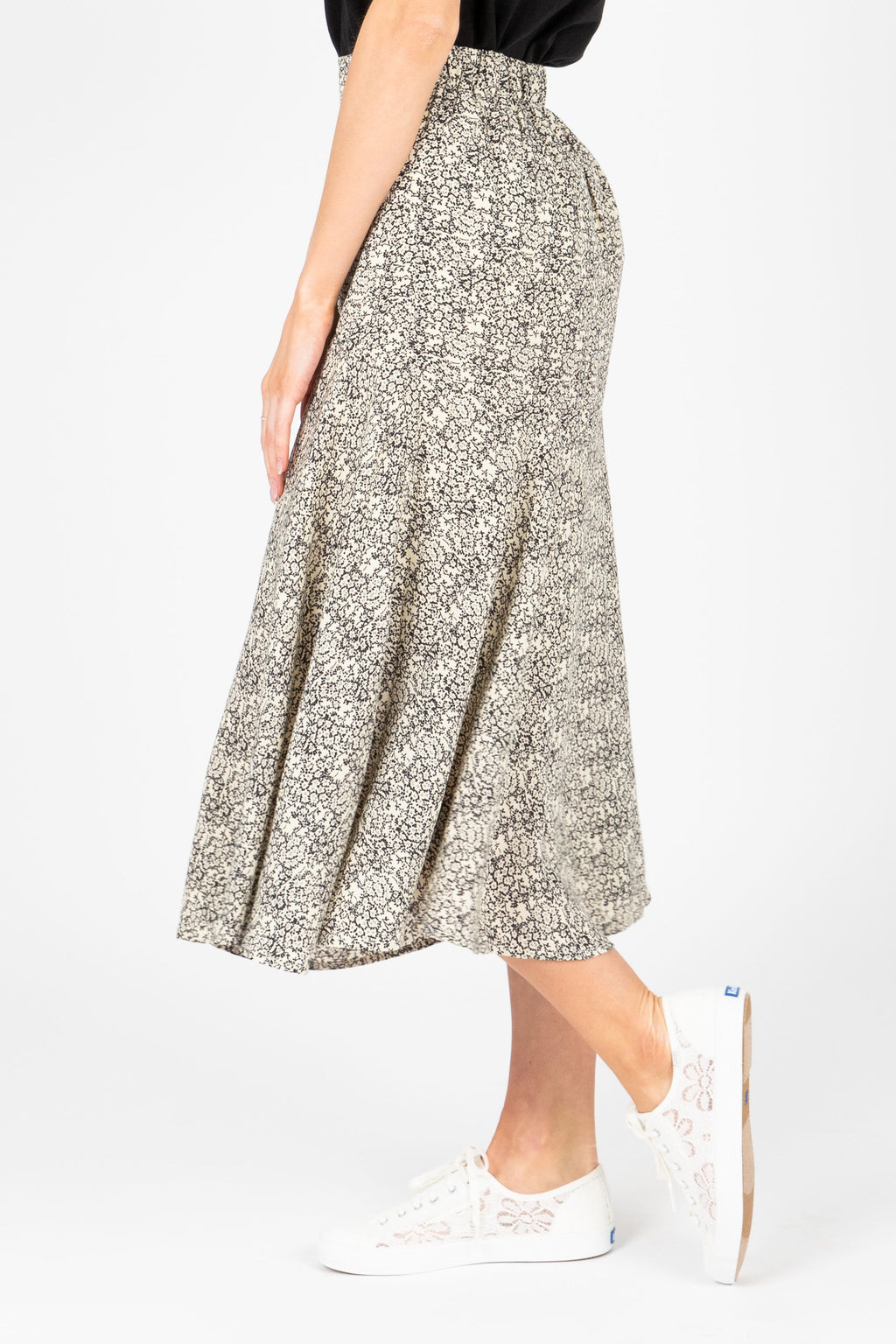 The Livia Patterned Skirt in Black, studio shoot; side view