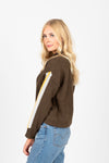 The Nadine Striped Detail Mock Neck Sweater in Olive, studio shoot; side view