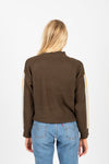 The Nadine Striped Detail Mock Neck Sweater in Olive, studio shoot; back view