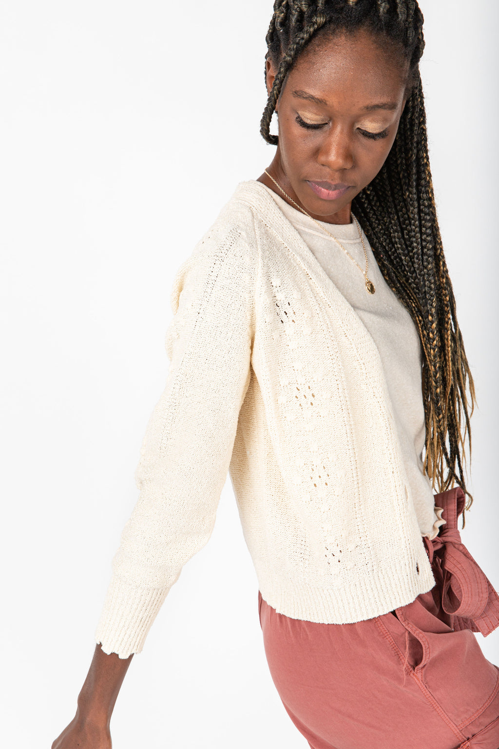 The Jessica Button Down Cardigan in Natural, studio shoot; side view