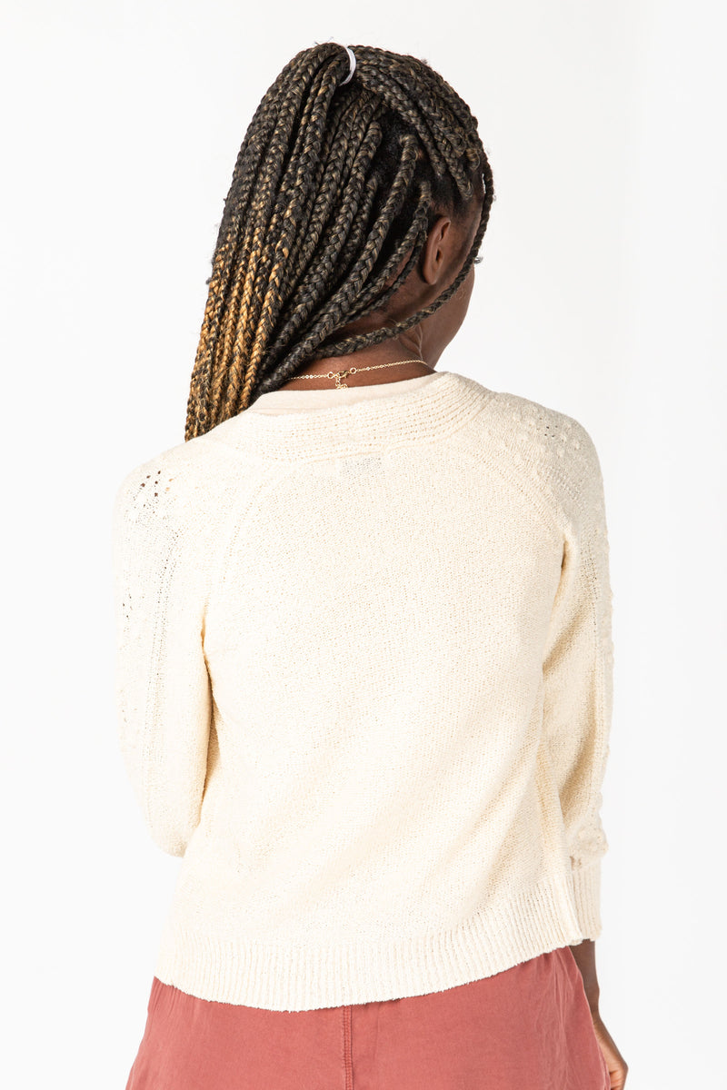 The Jessica Button Down Cardigan in Natural, studio shoot; back view