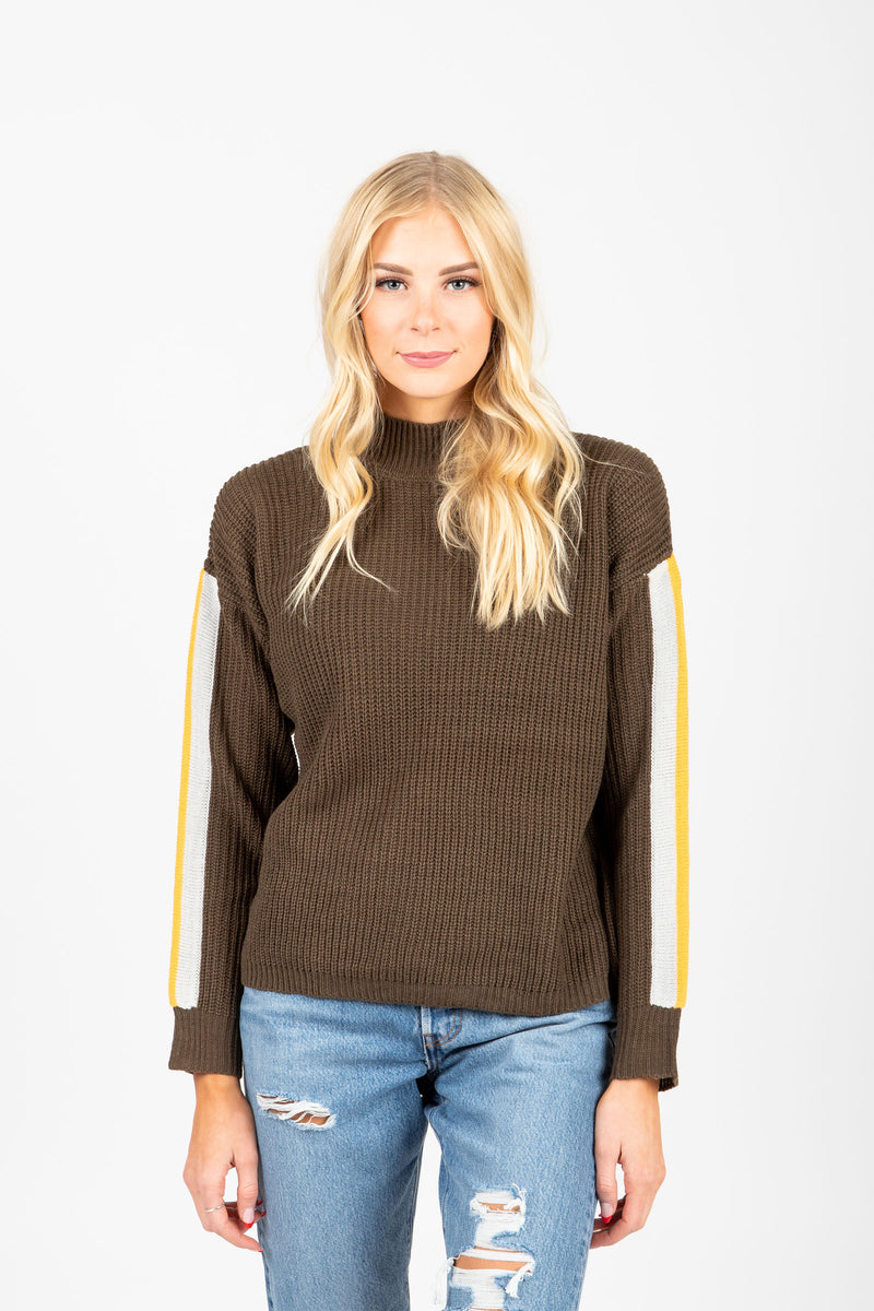 The Nadine Striped Detail Mock Neck Sweater in Olive, studio shoot; front view