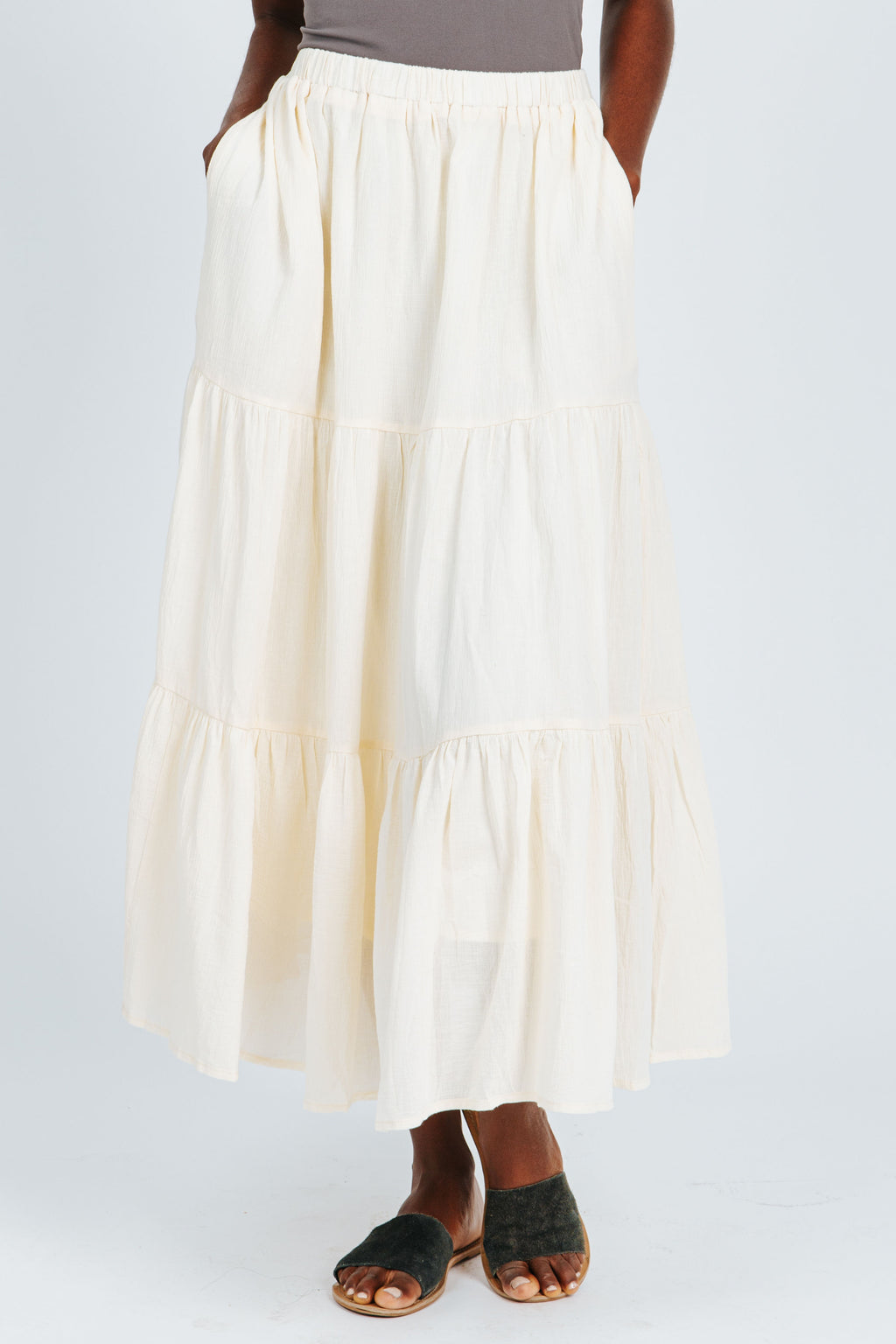 The Willow Tiered Skirt in Cream, studio shoot; front view