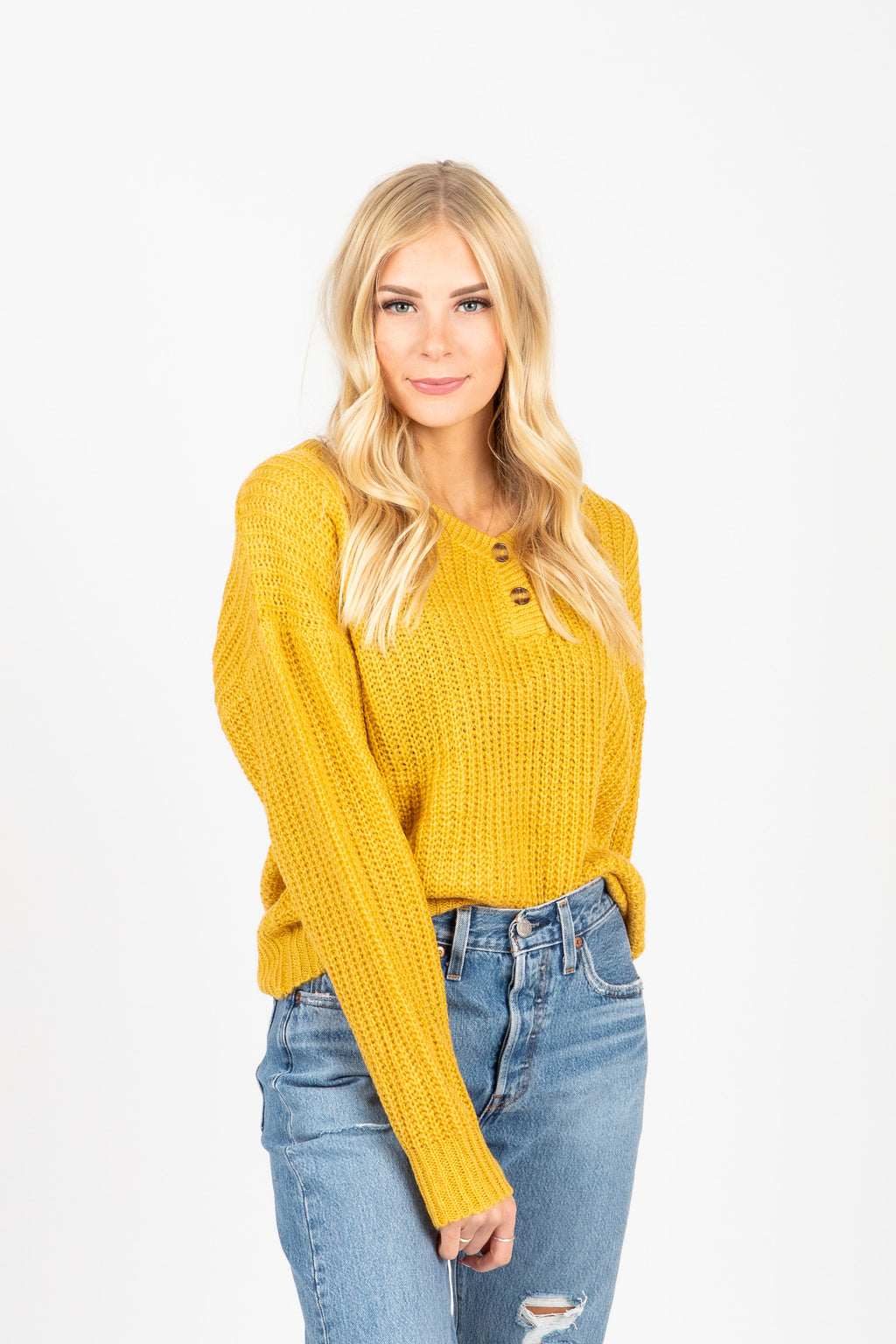 The Area Button Detail Sweater in Mustard, studio shoot; front view