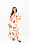 The Acuna Floral Wrap Dress in Blushy Peach, studio shoot; front view
