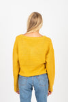 The Area Button Detail Sweater in Mustard, studio shoot; back view