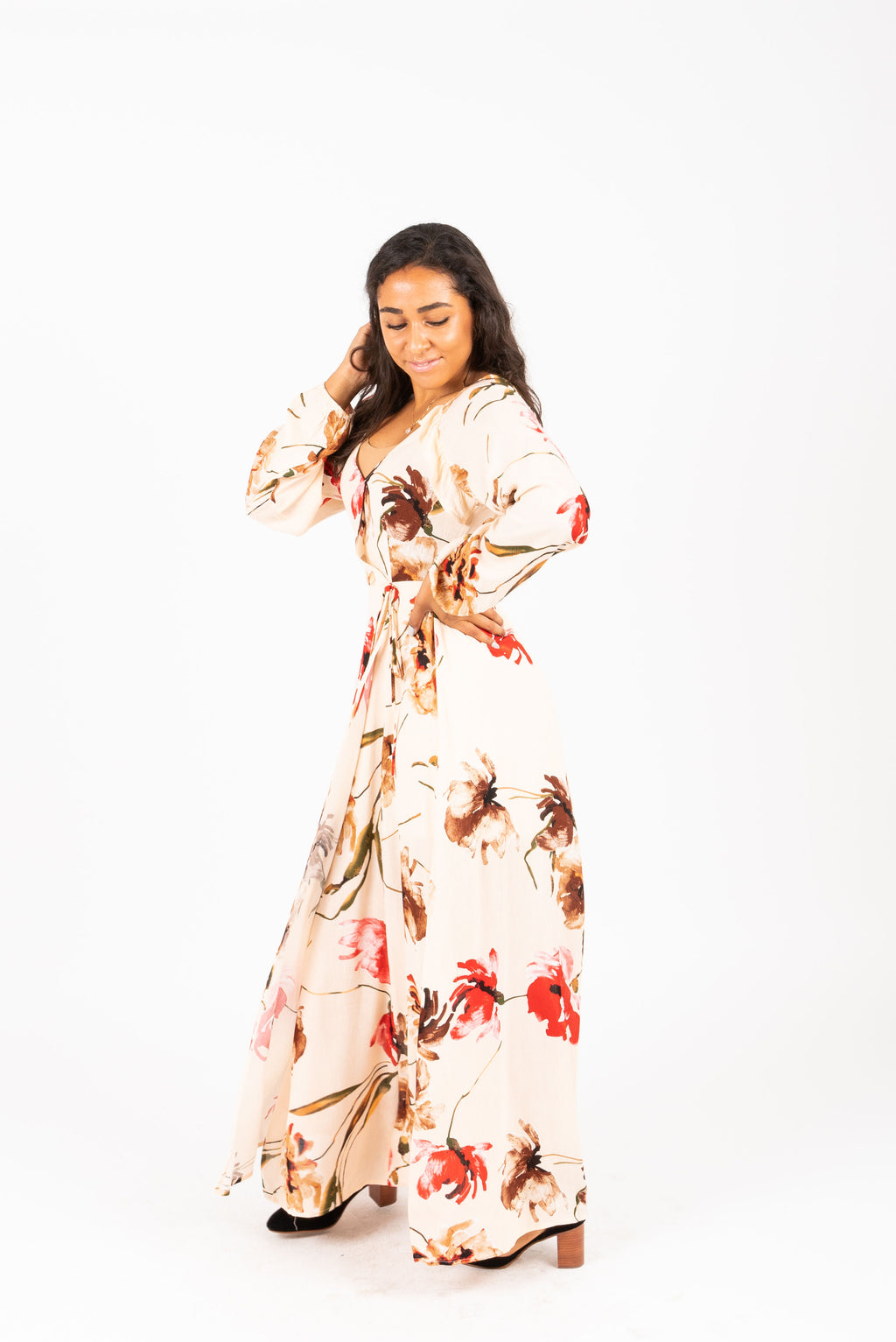 The Acuna Floral Wrap Dress in Blushy Peach, studio shoot; side view