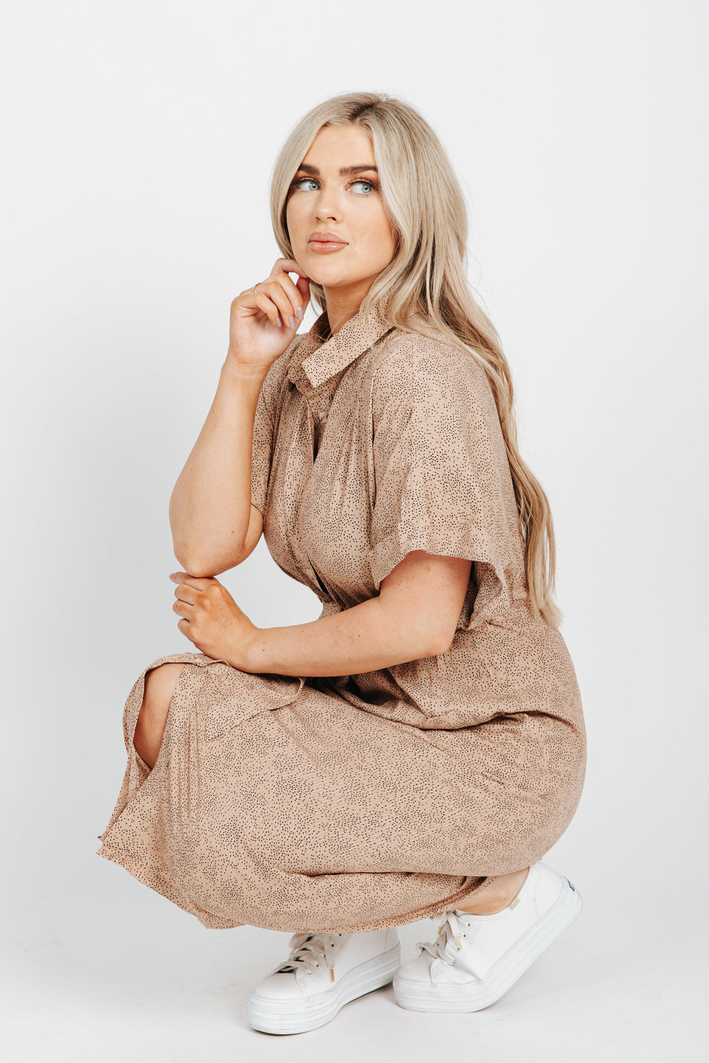 The Rima Dot Patterned Dress in Taupe, studio shoot; side view