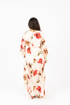 The Acuna Floral Wrap Dress in Blushy Peach, studio shoot; back view