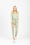 The Flora Loungewear Jogger Pants in Sage, studio shoot; front view