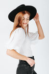 The Logan Puff Sleeve Blouse in White, studio shoot; side view