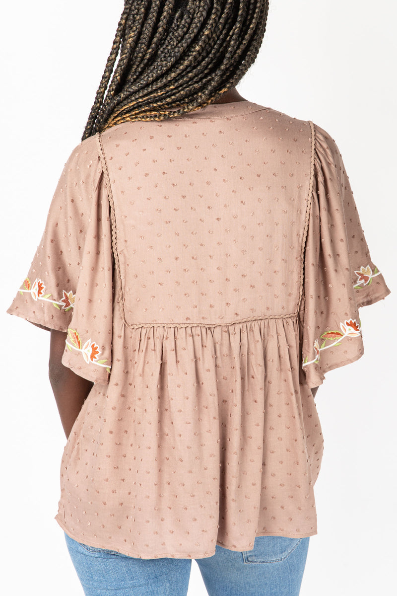 The Douglas Embroidered Swiss Dot Blouse in Taupe, studio shoot; back view