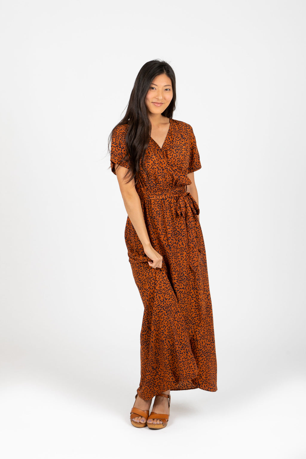 The Elise Patterned Wrap Dress in Rust, studio shoot; front view